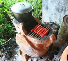 The Swan Stove Can also Cook and Grill